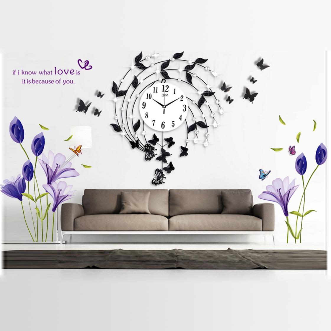 Đồng hồ treo tường họa tiết lá hoa và tặng kèm tranh dán tường tôn lên sự sáng tạo, sang trọng